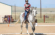 Cowboy Dressage rider trots through the box