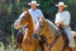 Eitan and Debbie Beth-Halachmy aboard their horses