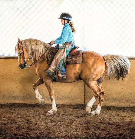 Cowboy Dressage rider performs a piaffe