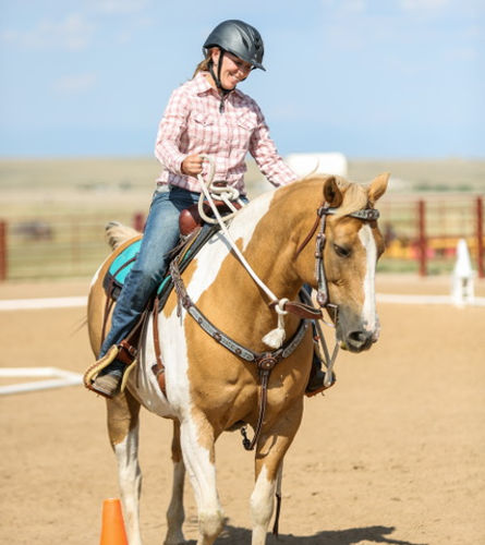 Rider an her horse compete in Cowboy Dressage of Colorado