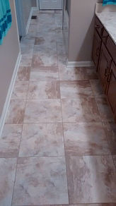"luxury vinyl tile, with pre mixed grout 15"" x 15"" installed by Eleet Flooring"