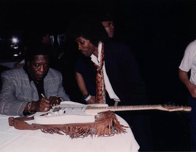 Buddy Guy autographs Skibby's guitar in the mid 1990's,
