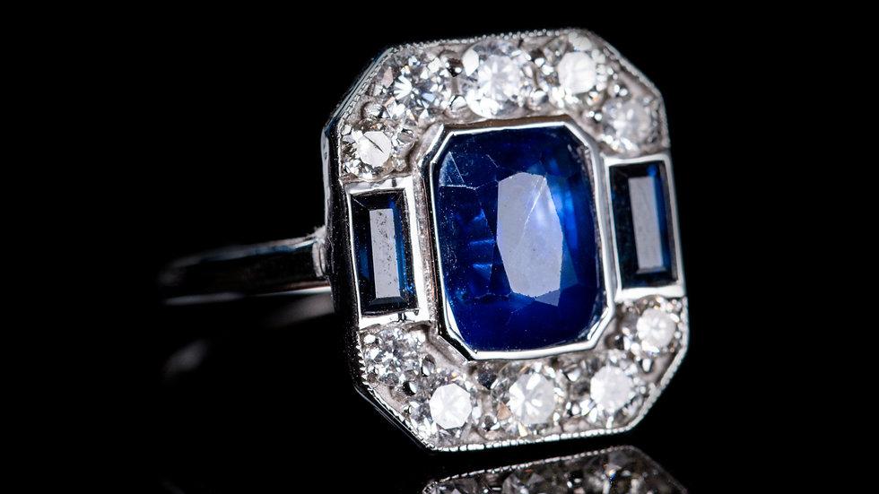 18ct White Gold 4ct Sapphire and 1ct Diamond Ring