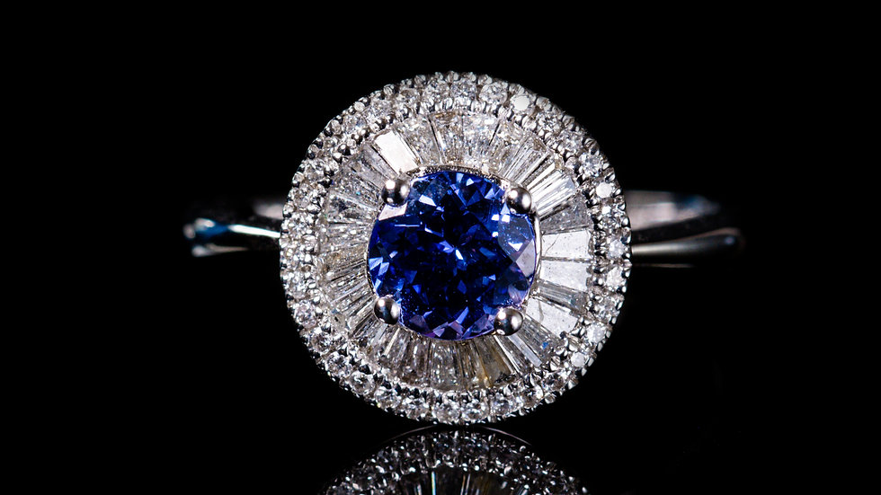 A tanzanite and diamond ring, modern floral cluster style