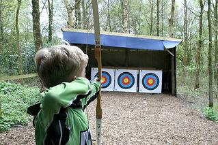 Boy doing archery at Stanley Head OEC