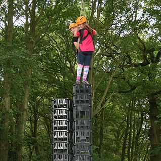 Youth group stacking crates at Stanley Head OEC