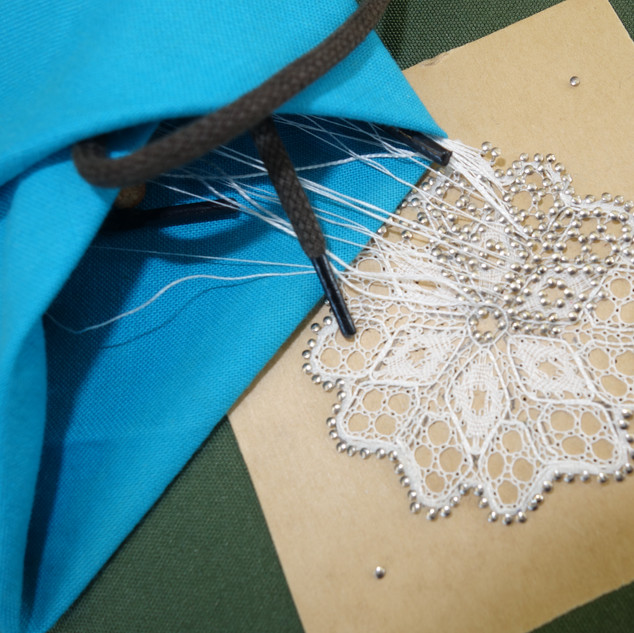 Lynn completing a bucks point mat from Pam Nottingham's book.