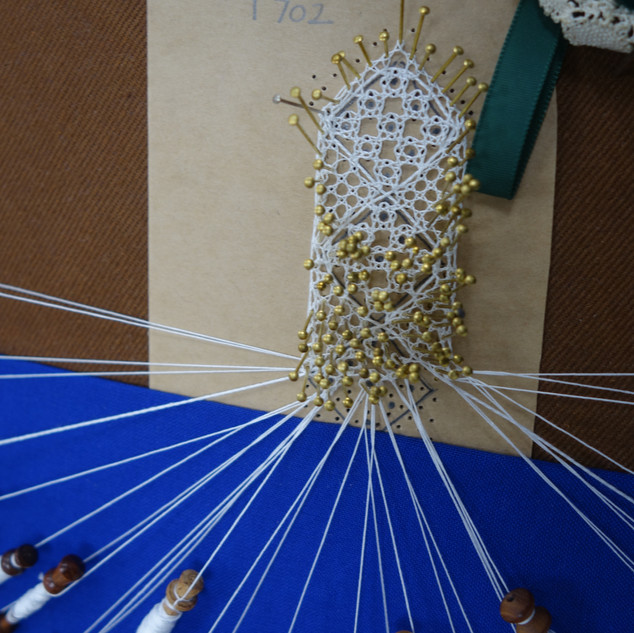 Gill returned to bobbin lace after a break of 20 years! Working well on the roseground sampler