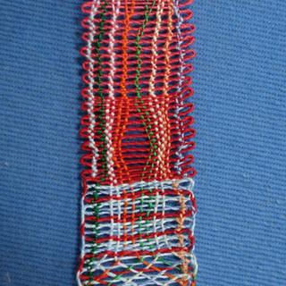 Rachel's first bobbin lace sampler completed.