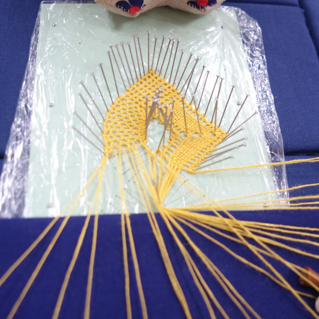 Helen sampled a 3D piece of bobbin lace which will need stiffening. The lace is made on acetate or in this case cling film to protect the lace pillow during stiffening.