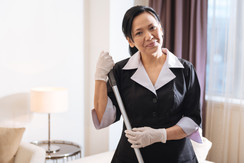 Delighted positive chambermaid looking a