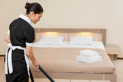 chambermaid-cleaning-hotel-room_23-21480