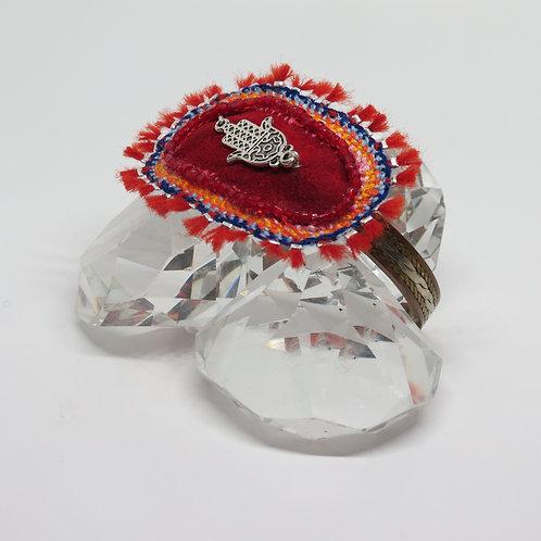 Fire red sunburst bracelet.