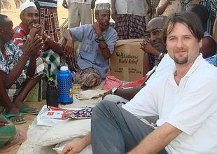 Tom sitting with village elders in Somal
