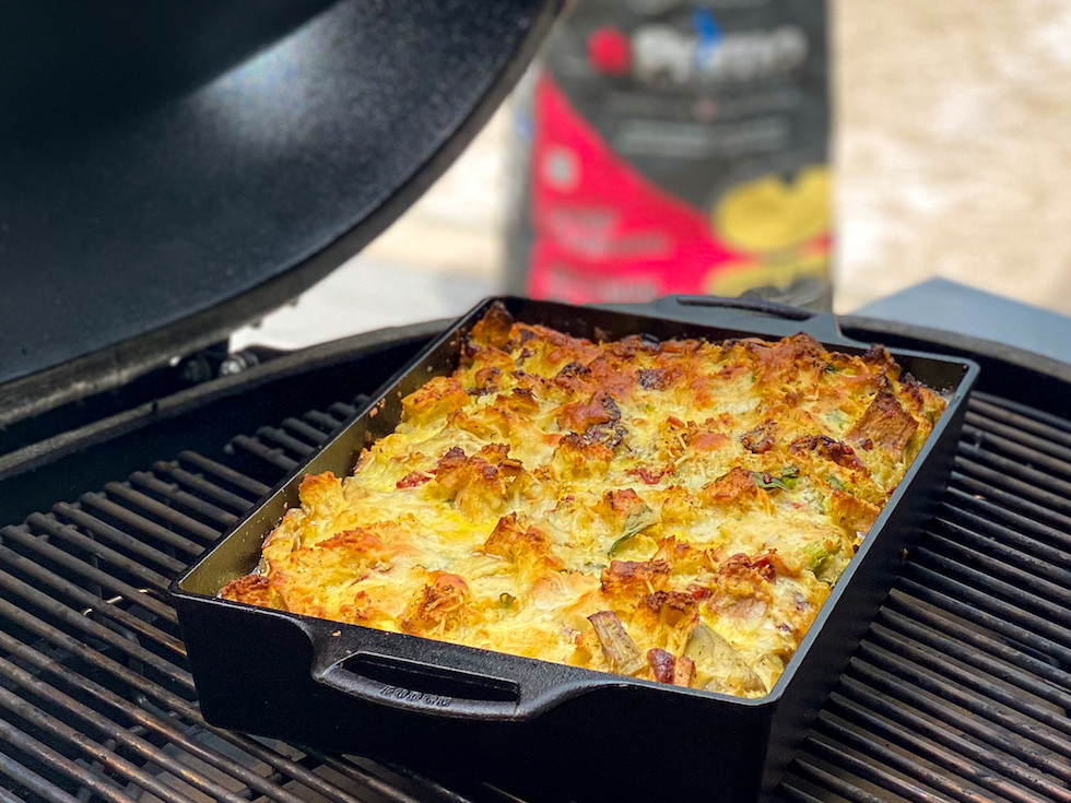 Baked Italian Strata with Primo Lump Charcoal in the background.