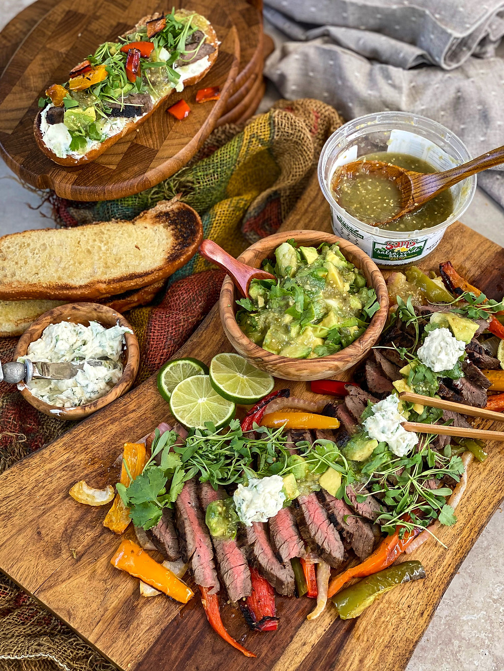An overview of a table set for creating a salsa verde steak tartine.