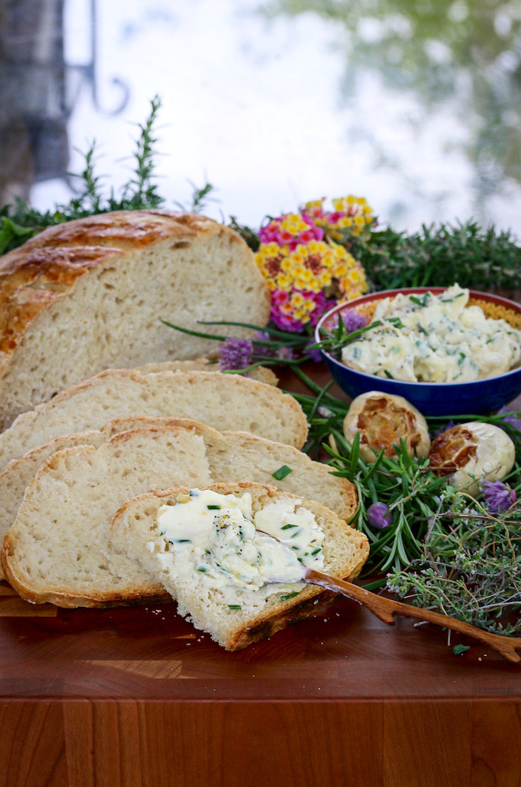 Sourdough bread sliced with roasted garlic butter.