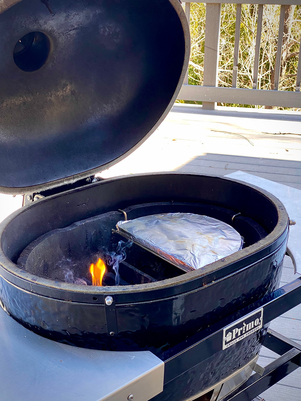 A Primo Grill that has been set up for 2-zone cooking.
