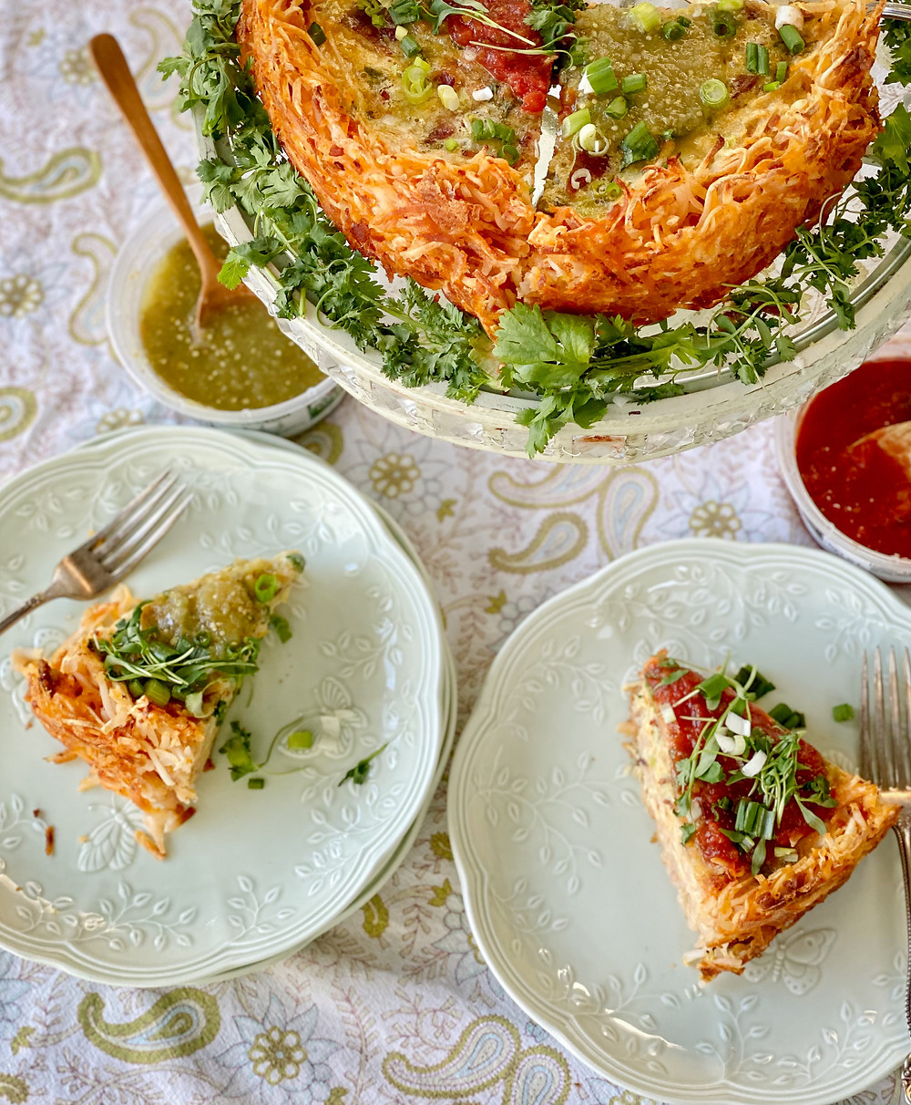 Slices of red and green salsa topped hash brown quiche.