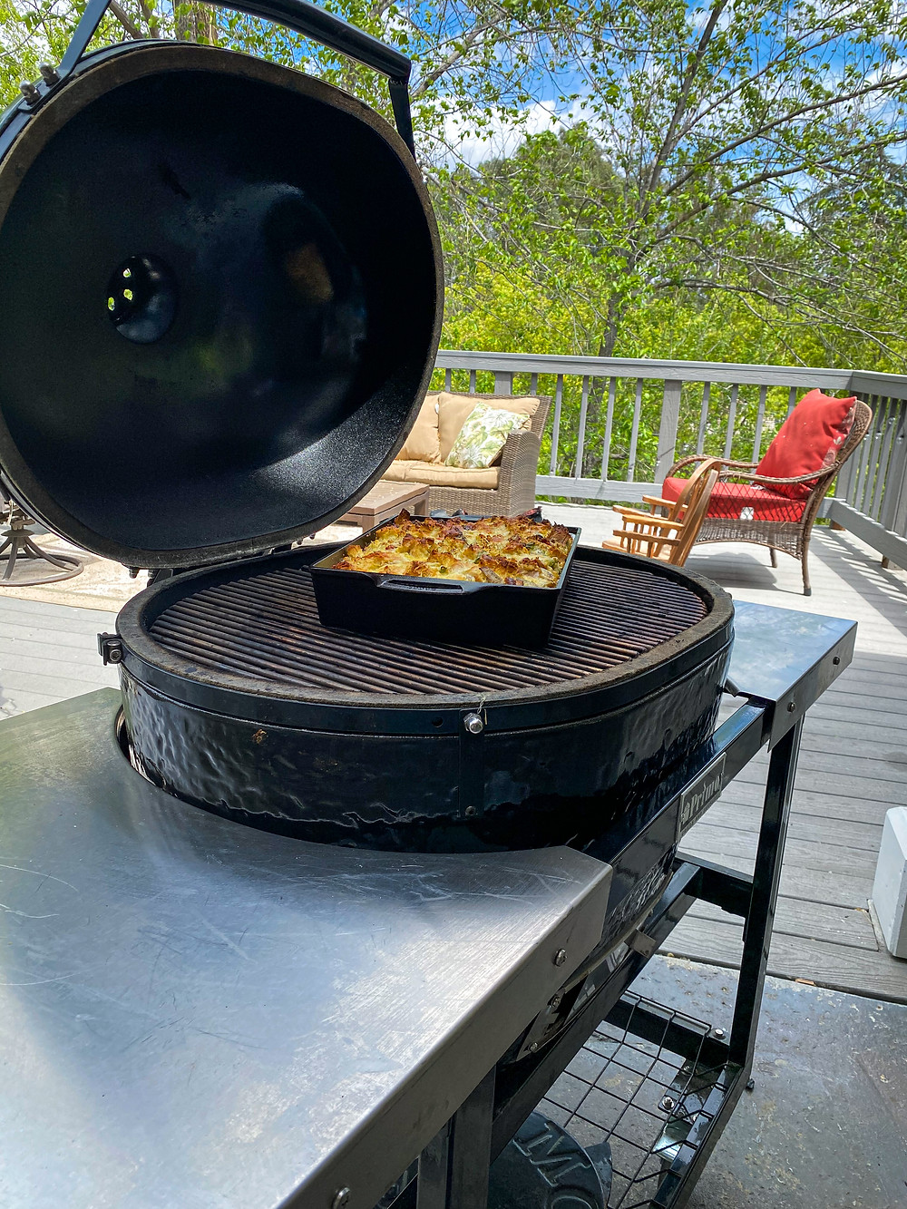 Primo Grill with a smoked strata in a casserole pan.