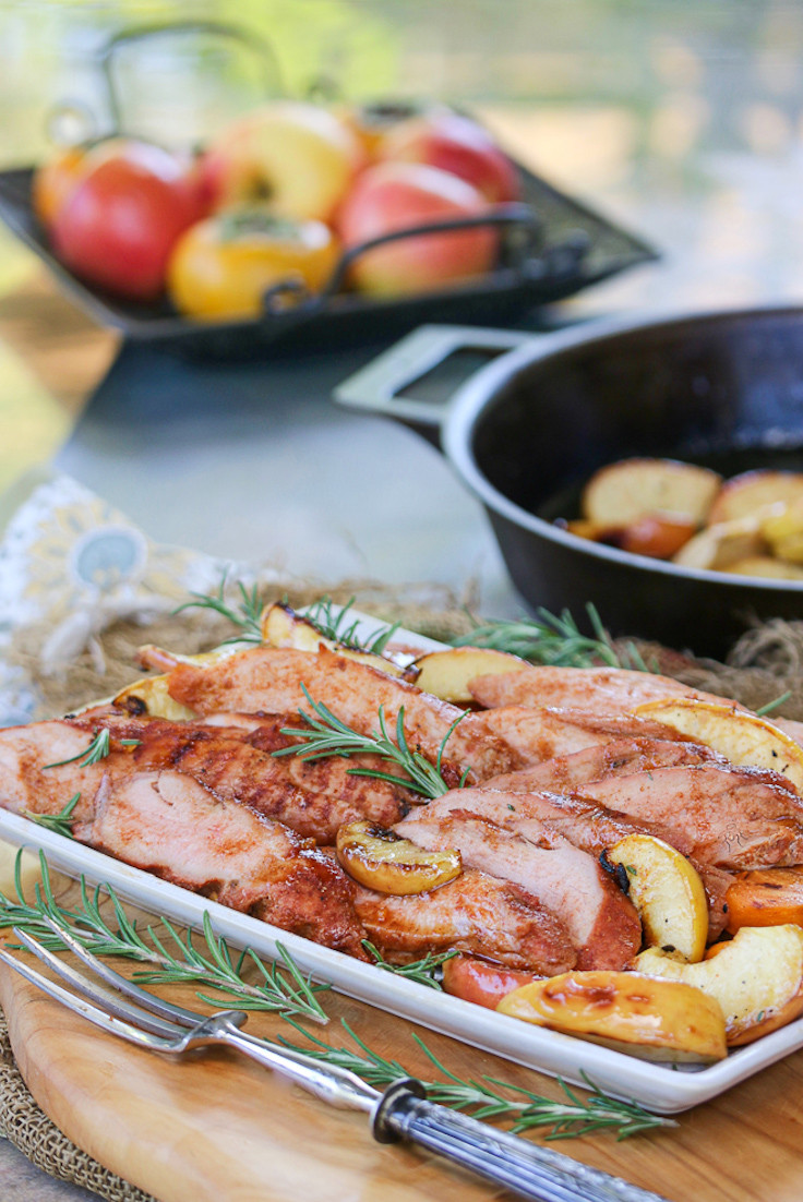 Apples and Persimmons in background with a platter of smoked pork.