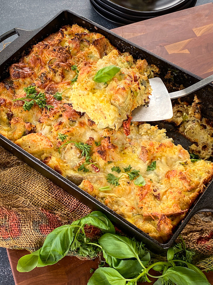 Toasty strata made with bread, cheese, milk, artichokes and bacon.