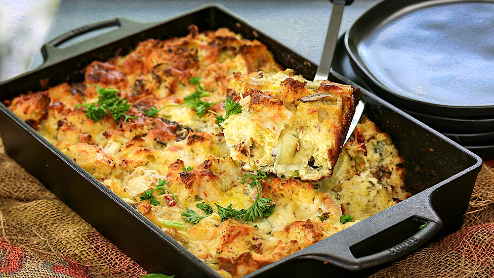 A strata baked in cast iron casserole dish ready to plate.