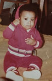 DC - Childhood - Baby Pic - sitting up.j