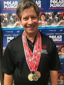 Jonathan with medals2.jpg