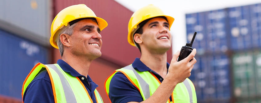 2-men-in-hard-hats-with-walkie-talkie-an