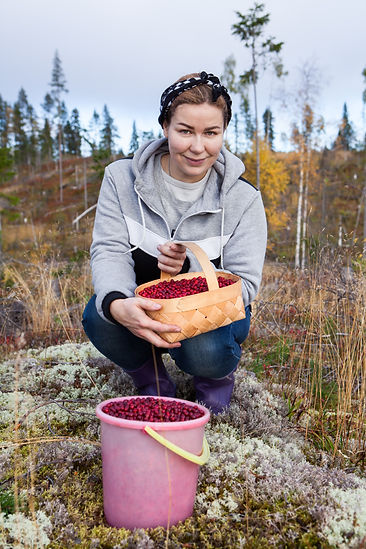 Woman sitting in autumn forest with a ba