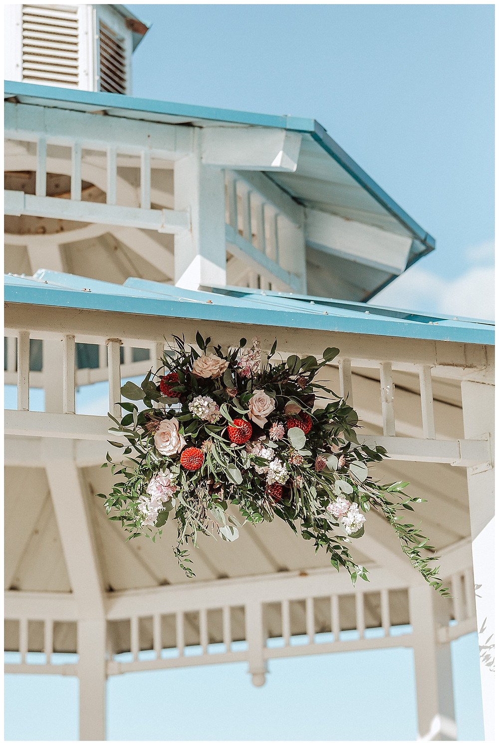Floral Detail Over Wedding Ceremony Gazebo
