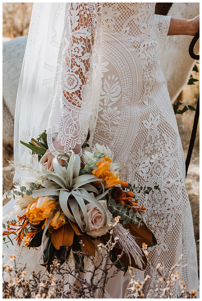 Boho Lace Long Sleeve Wedding Dress with Autumn Inspired Air Plant Bouquet
