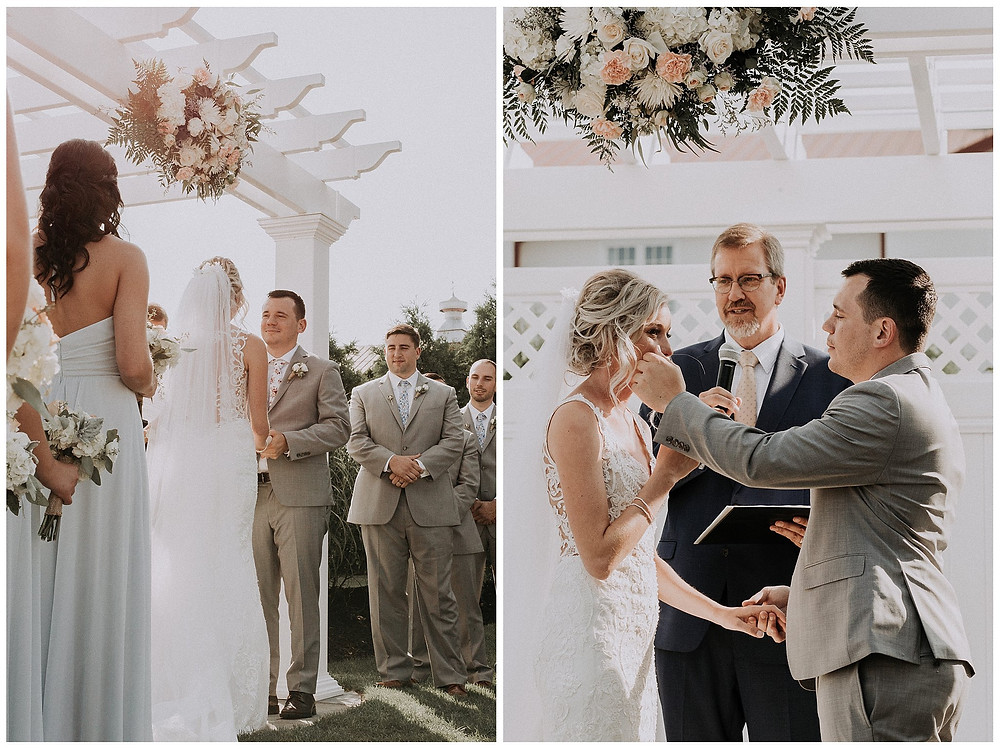 Groom Wiping Bride's Tear at Ceremony