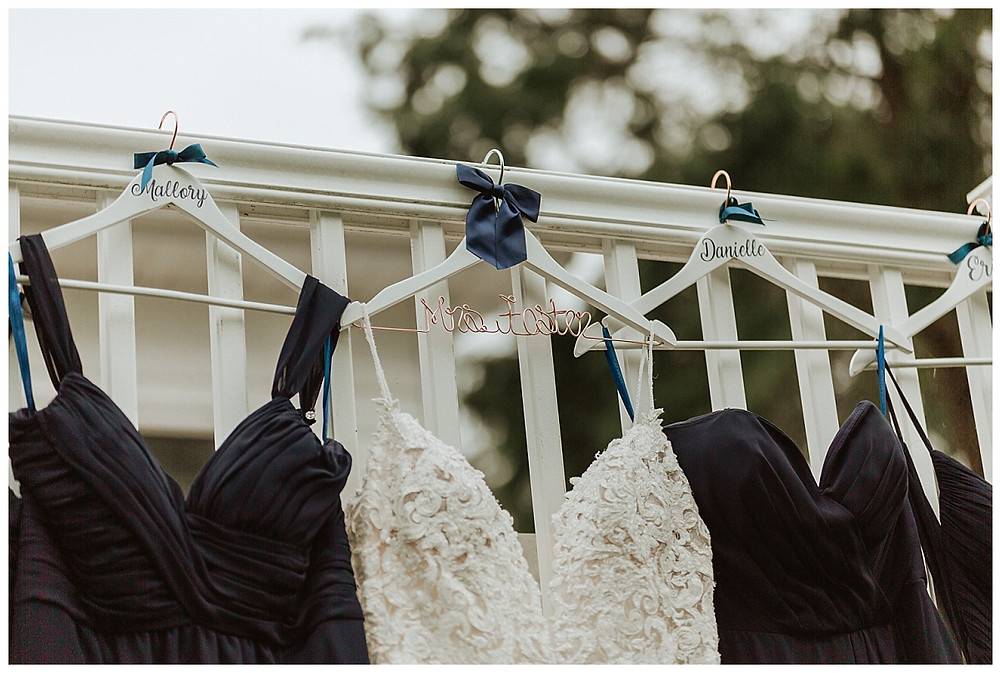 Wedding Dress and Bridesmaids Dresses Hanging