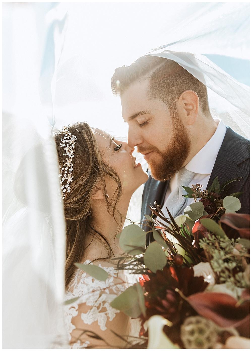 Romantic Bride and Groom Veil Shot Portraits