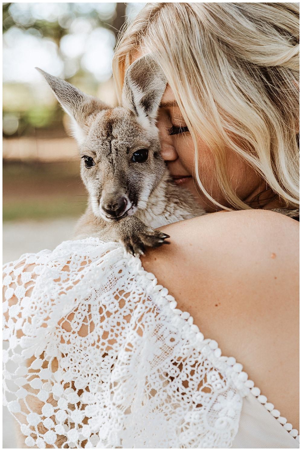 Bridal Portraits with Baby Kangaroo at Enchanted Oaks Farm in Ocala Florida