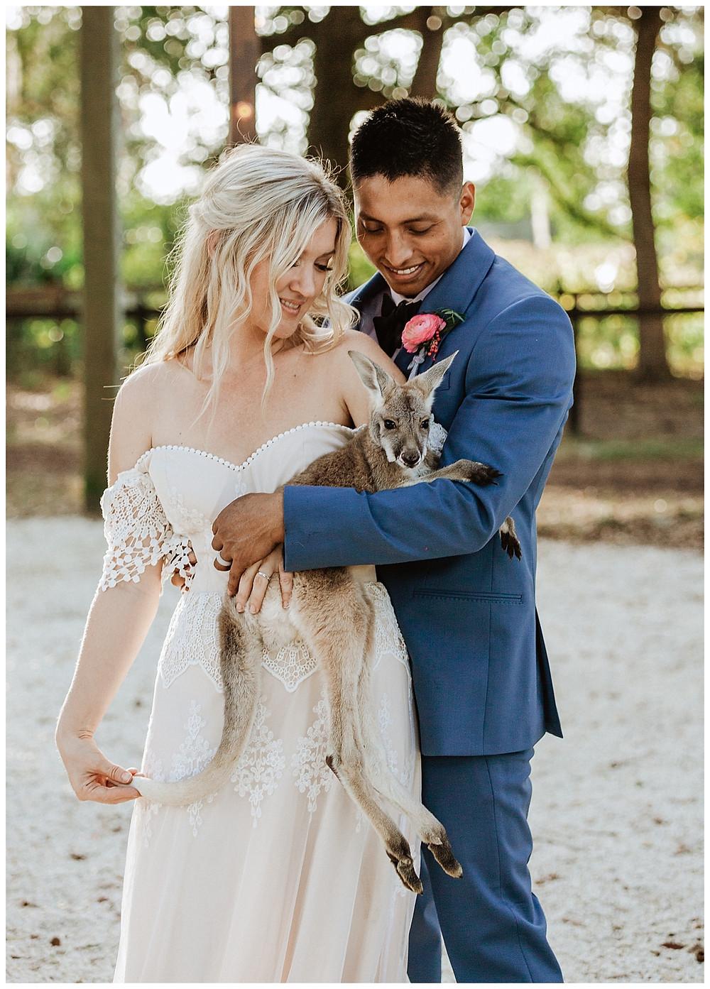 Boho Bride & Groom Portraits with Baby Kangaroo at Enchanted Oaks Farms, Ocala Florida