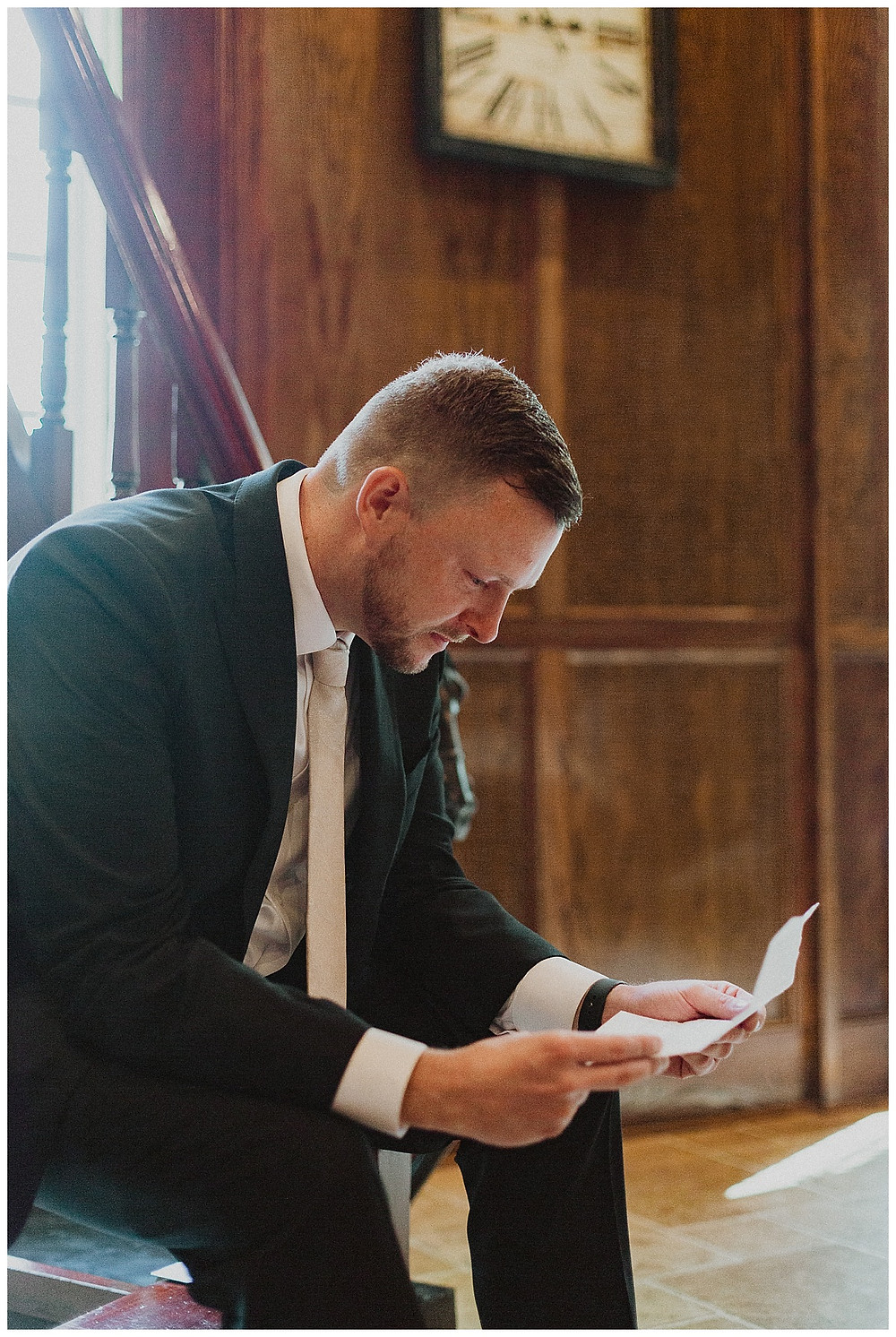 Groom Portrait Reading Letter From Bride