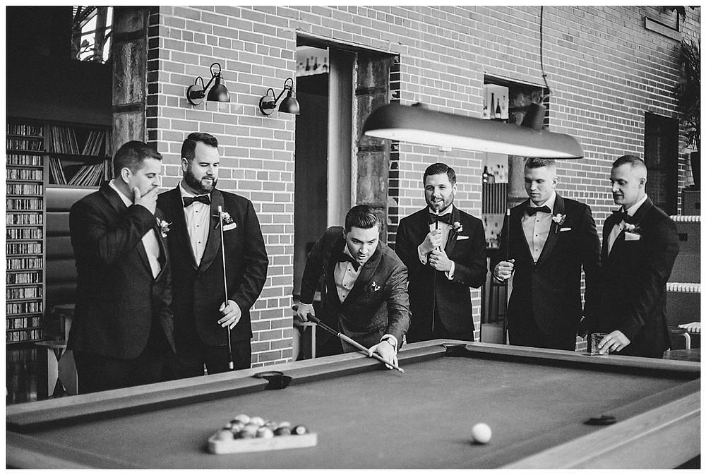 Groomsmen playing billards