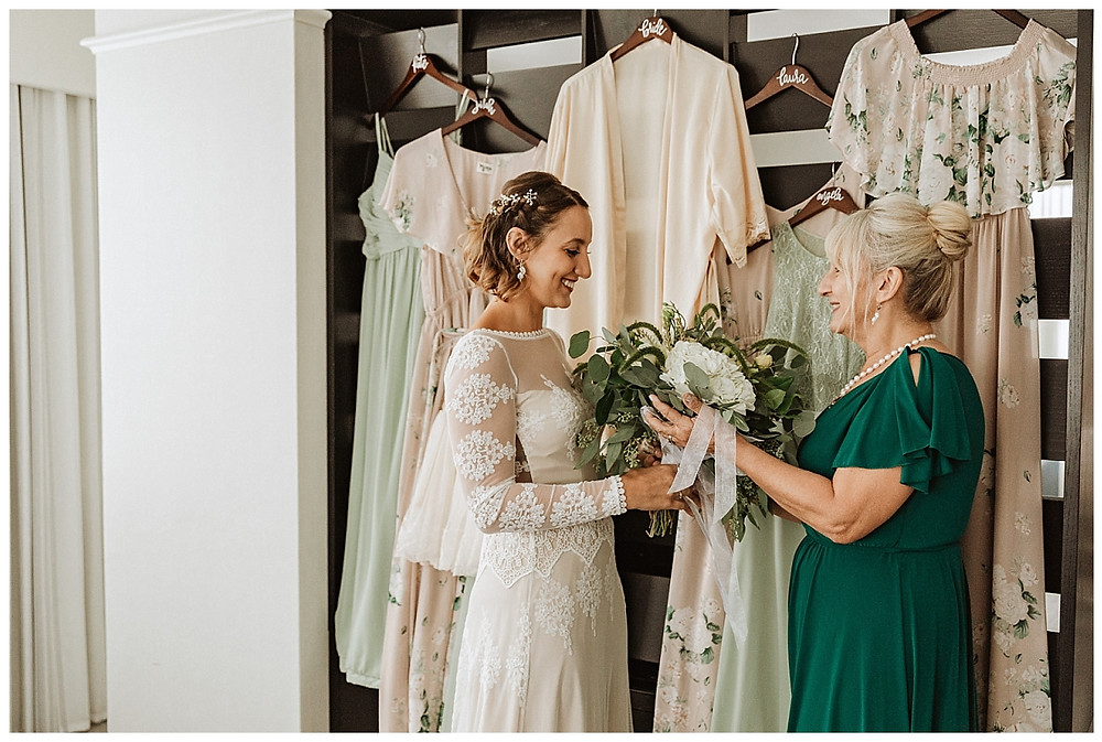 Bride Getting Ready in Dreamers and Lovers Wedding Dress