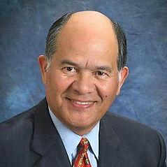 Dr. Loui Olivas