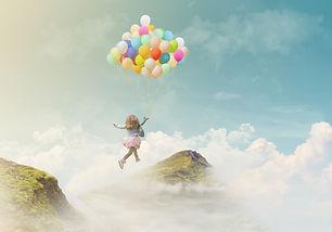 Little girl holding colorful balloons, j