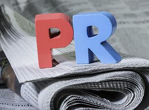 Word PR on newspaper. Wooden letters.jpg