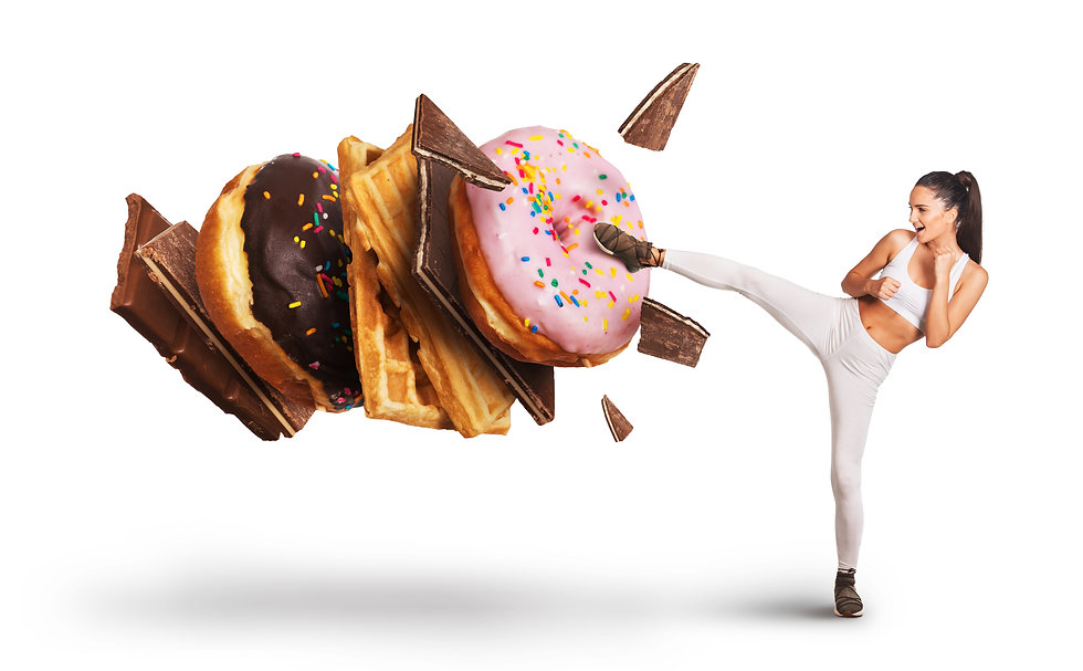 Fit young woman fighting off sweets and