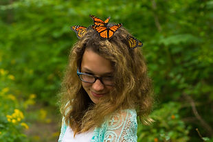 Girl With Monarchs In Hair
