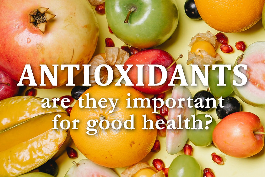 """A variety of fruits and vegetables in the background with the text """"Antioxidants are they important for good health?""""."""