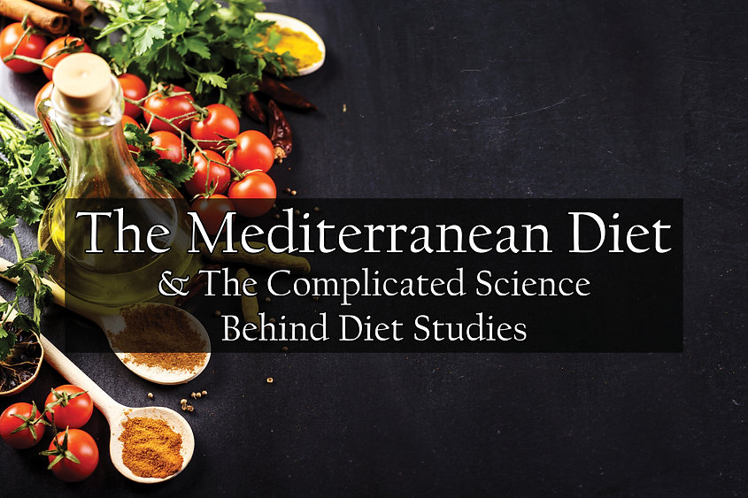 """A table featuring foods from the Mediterranean diet and the words: """"The Mediterranean Diet & The Complicated Science Behind Diet Studies""""."""