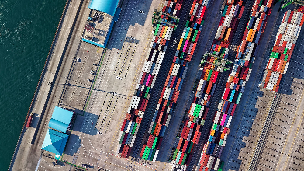 Many cargo containers well-organized on a loading dock.