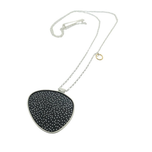 Dotty egg necklace with silver chain.